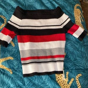 A black white red and grey striped top